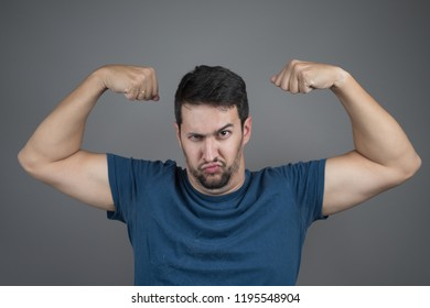 gesture of being strong pulling arm