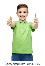 gesture, childhood, fashion and people concept - happy smiling boy in green polo t-shirt showing thumbs up