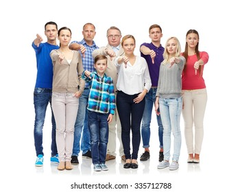 gesture, family, gender, generation and people concept - group of men, women and boy giving thumbs down