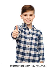 gesture,  gender, childhood, fashion and people concept - smiling boy in checkered shirt and jeans showing thumbs up