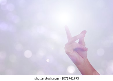 gesture of hand is show good idea snap finger isolated on bokeh background