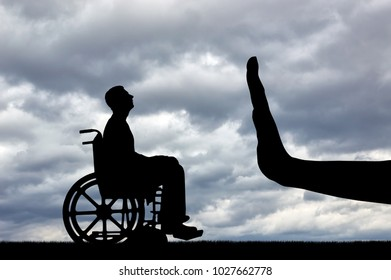 Gesture Hand Stop and disabled in a wheelchair looking for a job. Concept of Discrimination in Employment of People with Disabilities