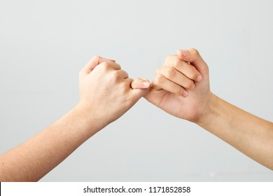 The gesture of the hands mean promise