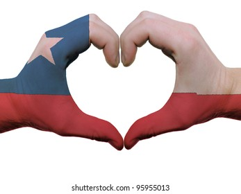 Gesture made by chile flag colored hands showing symbol of heart and love, isolated on white background