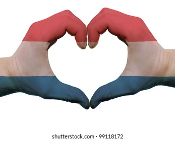 Gesture made by holland flag colored hands showing symbol of heart and love, isolated on white background