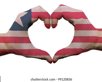 Gesture made by liberia flag colored hands showing symbol of heart and love, isolated on white background