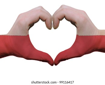 Gesture made by poland flag colored hands showing symbol of heart and love, isolated on white background