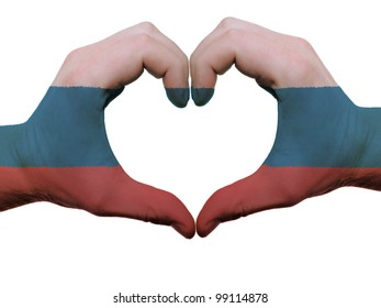 Gesture made by russia flag colored hands showing symbol of heart and love, isolated on white background