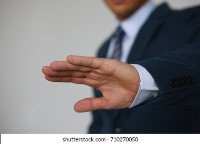 Gesture male hand rejection says no male businessman in a suit on a gray background I will not categorically claim - Shutterstock ID 710270050