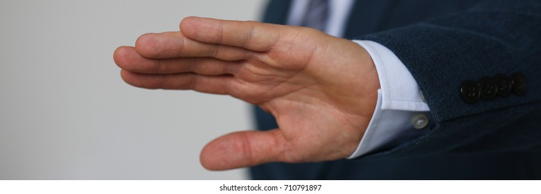 Gesture male hand rejection says no male businessman in a suit on a gray background I will not categorically claim - Shutterstock ID 710791897