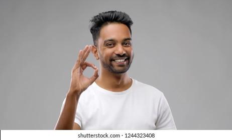 gesture and people concept - happy indian man in t-shirt showing ok hand sign