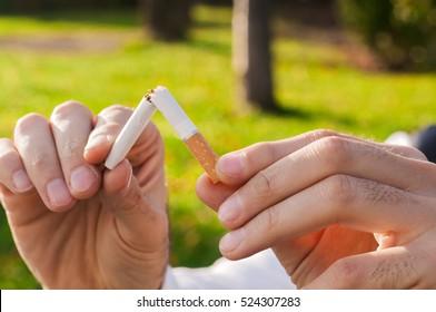 Gesture for quit smoking, Anti Smoking,  male hand crushing cigarette, Non Smoker. man has decided to stop smoking.