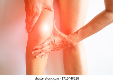 Gesture showing pain in the muscles and bone, joint, knee of a person