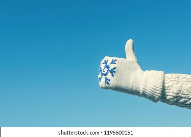 Gestures of hands in the winter mittens.Hand Thumb Up and good symbol. Concept