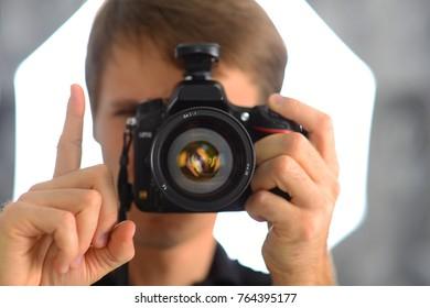 Gestures of man photographer journalist reporter operator selfie in mirror. Camera photo shot.