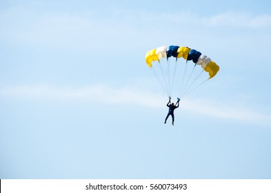 gestures of skydiving parachute extreme sport adventure fly on blue sky