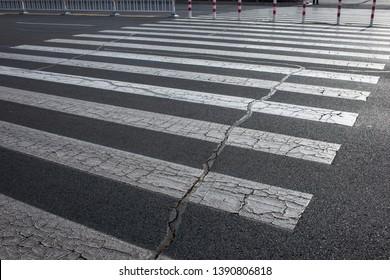 Get a close-up of the zebra crossing