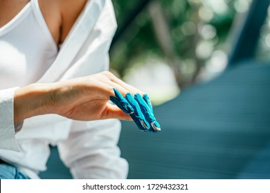 Get Crafty. Close up of woman hand dirty with acrylic paint. Female artist using hand while adding blue color. Creative finger painting. Horizontal shot. Selective focus