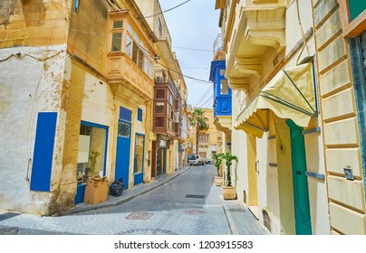 Get lost in quiet residential streets of old town with scenic edifices, small shops and art galleries, Victoria, Gozo, Malta.