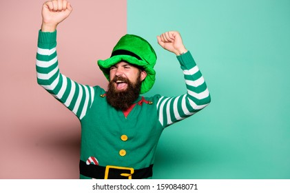 get lucky. st patricks day. happy bearded hipster in green hat. christmas elf. happy celebration. man with beard have fun. ireland beer tradition. Winter carnival. irish pub party. mature leprechaun.