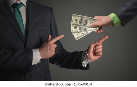 Get money concept. Financial help. Cashback. Bank loan. Businessman is showing by his index on a hand with a cash on a gray background.