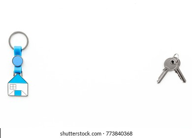 Get a mortgage. Apartment keys on white background top view copyspace