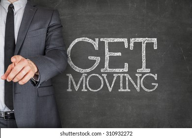 Get moving on blackboard with businessman finger pointing