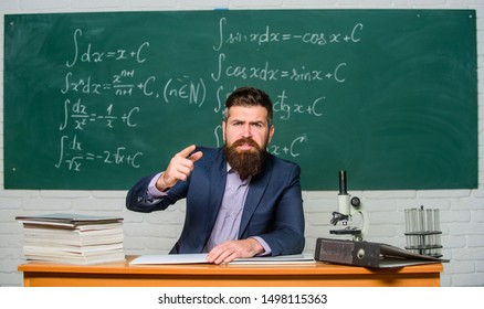 Get out of class. Teacher strict serious bearded man chalkboard background. Teacher looks threatening. Rules of school behaviour. School principal threatening with punishment. Demanding teacher.