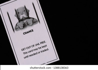 Get out of Jail Free Card from Hasbro's Monopoly, against a black background - Illustrative Editorial