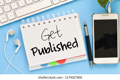 GET PUBLISHED inscription in notepad on table