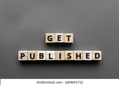 Get published - words from wooden blocks with letters, get published concept, top view gray background