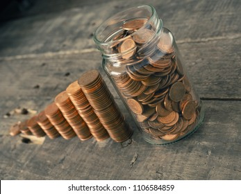 Get rich, stacked coins on a wooden table