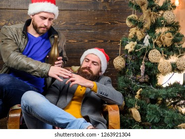 Get rid of harmful habits. How to break bad habits. Men drink champagne and smoking. New years resolution. Brutal men celebrate new year near christmas tree. Bad habits to kick before the end of year.