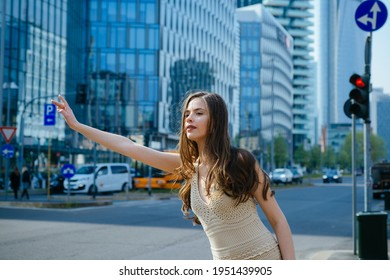 Get taxi. Woman catching car on city street. Travel, tourism and people concept. Fashion street