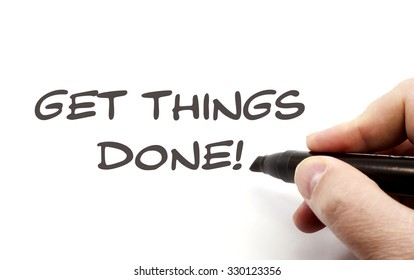 Get Things Done handwriting concept being written with a black marker.