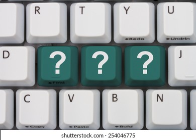 Getting Answers Online, A gray computer keyboard with the question mark symbols in teal letters