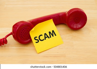 Getting a call that is an scam, A retro red phone with yellow sticky note on a desk with text Scam