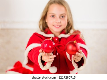 Getting child involved decorating. How to decorate christmas tree with kid. Girl smiling face hold balls ornaments white interior background. Let kid decorate christmas tree. Favorite part decorating.