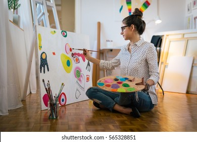 Getting creative.woman painting in her art studio