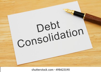 Getting a Debt Consolidation Loan, A card and pen on a desk with text Debt Consolidation Loan