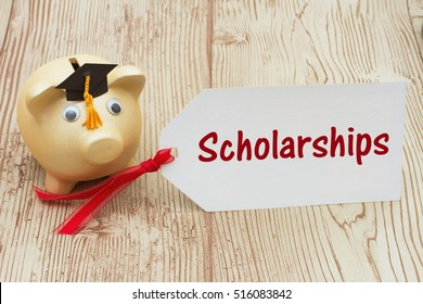 Getting a educational scholarship, A golden piggy bank and grad cap on a desk with a gift tag with text Scholarships