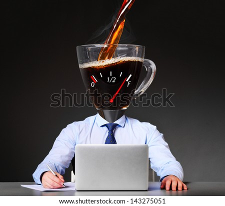 getting energy with coffee. businessman with cup instead of his head