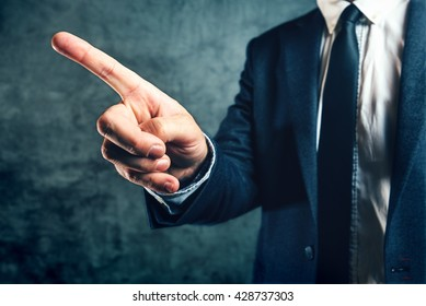 Getting fired from job, office manager showing way out with finger pointing to exit door.