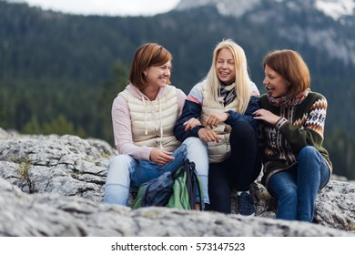 Getting a good dose of nature. Three young woman laughing  while out for a mountain hike