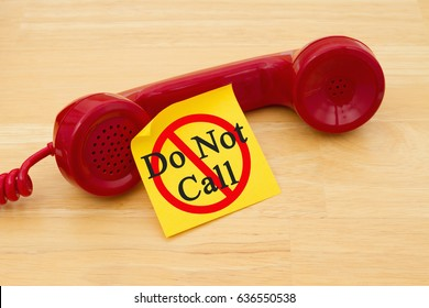 Getting on the do not call list, Retro red phone handset with a yellow sticky note and text Do not call
