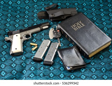 Getting ready to go to church, showing a bible, car keys,wallet,and a handgun