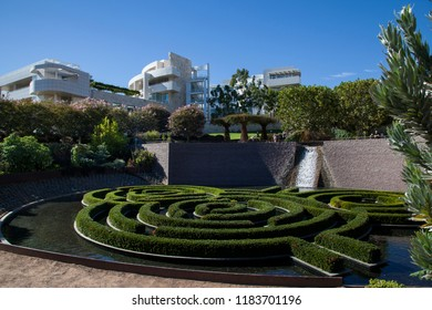 Getty Center and Garden, Los Angeles, California, September 2018 - The garden and decorative hedges behind the Getty Center Museum in the afternoon light.