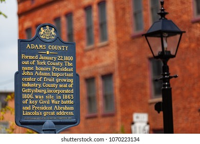 Gettysburg, PA, USA - June 30, 2013:  The Adams County Historical Marker sign is located near the current courthouse in downtown Gettysburg.