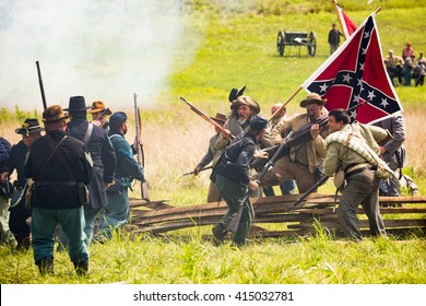 GETTYSBURG, PENNSYLVANIA - AUGUST 09, 2015: Confederate soldiers breach an union barricade during the Battle of Gettysburg reenactment.