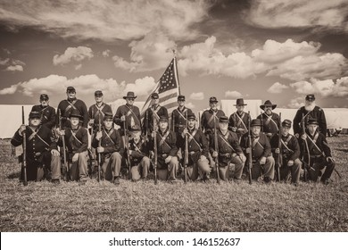 GETTYSBURG, PENNSYLVANIA - JULY 5: Union soldiers pose for a group photo at the reenactment commemorating the 150th anniversary of the Civil War battles on July 5, 2013 in Gettysburg, Pennsylvania